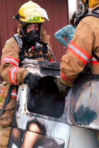 Firefighters Remove Burned Dryer